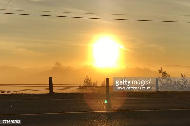 scenic view of road against sky during sunset - sudbury canada stock photos and pictures