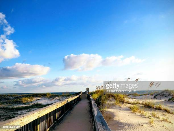 scenic view of road against sky - gulf shores alabama stock pictures, royalty-free photos & images