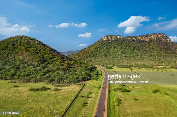 scenic view of road amidst field against sky - paraguay stock pictures, royalty-free photos & images
