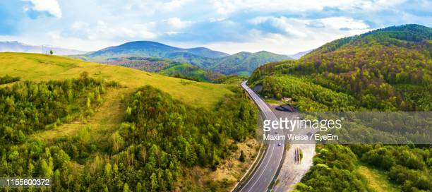scenic view of road amidst mountains against sky - ukraine landscape stock pictures, royalty-free photos & images