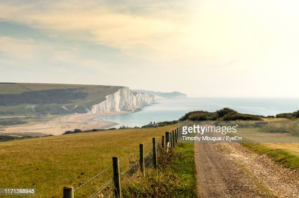 scenic view of road by land against sky - national park stock pictures, royalty-free photos & images