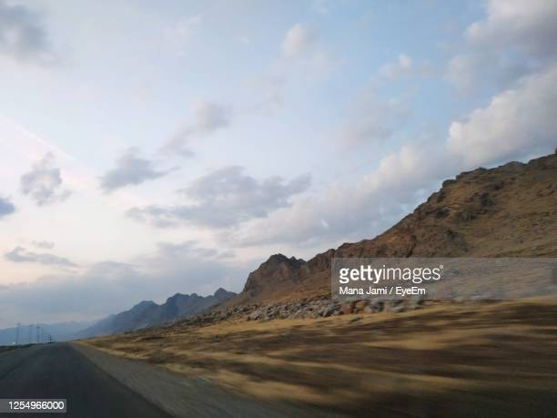 scenic view of road by mountains against sky - irak photos et images de collection