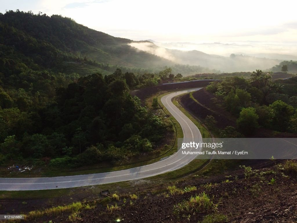 Scenic View Of Road By Mountains Against Sky : Stock Photo