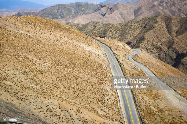 Scenic View Of Road Leading Towards Mountains