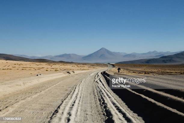 scenic view of road through the desert at altiplano, bolivia - silver shoe stock pictures, royalty-free photos & images