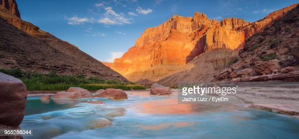 scenic view of rock formation against sky at sunset - grand canyon national park stock photos and pictures