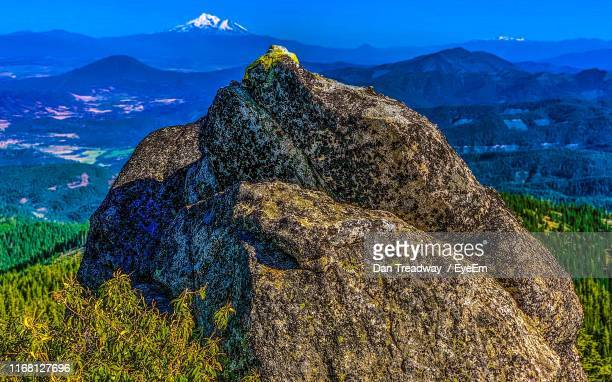 scenic view of rock formation against sky - dan peak stock photos and pictures