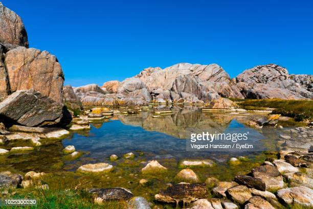 scenic view of rock formations against blue sky - vegard hanssen stock pictures, royalty-free photos & images