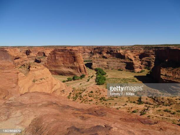 scenic view of rock formations against clear blue sky,canyon de chelly,arizona,united states,usa - canyon de chelly national monument stock pictures, royalty-free photos & images