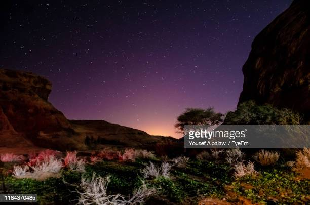 scenic view of rock formations against sky at night - gulf countries stock pictures, royalty-free photos & images