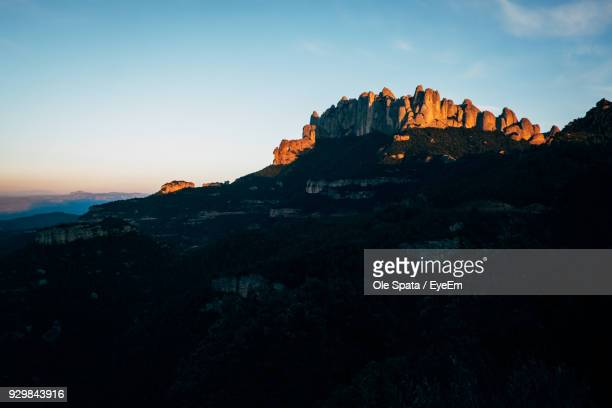 scenic view of rock formations against sky - tarragona stock photos and pictures