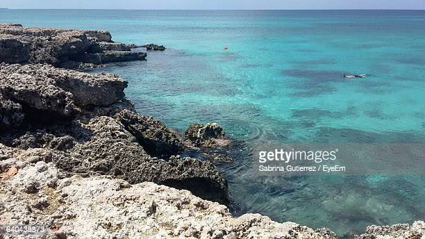 Scenic View Of Rock Formations And Sea