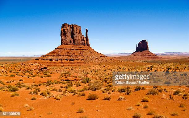 Scenic View Of Rock Formations At Monument Valley