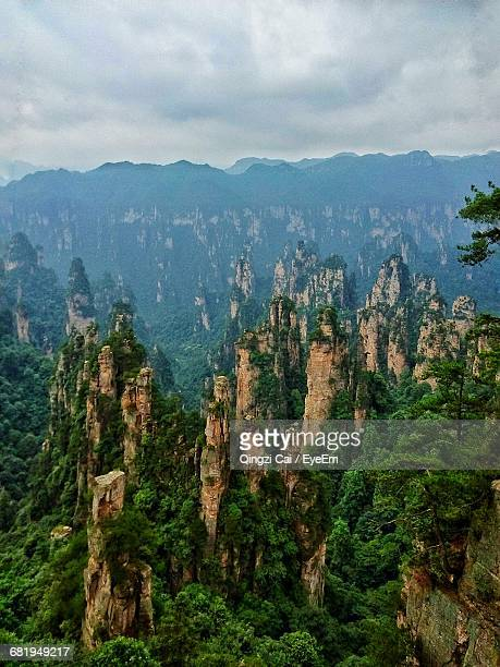 Scenic View Of Rock Formations At Zhangjiajie National Forest Park Against Cloudy Sky