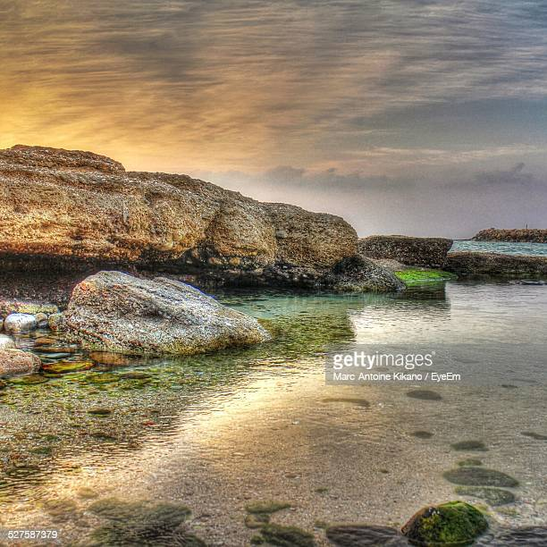 Scenic View Of Rocks At Beach