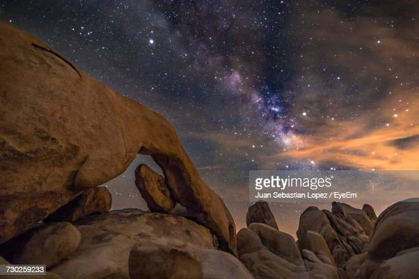 scenic view of rocks at night - joshua tree stock photos and pictures