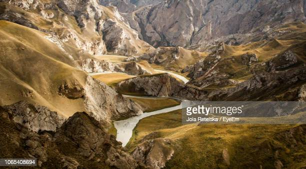 scenic view of rocks in mountains - kyrgyzstan stock pictures, royalty-free photos & images