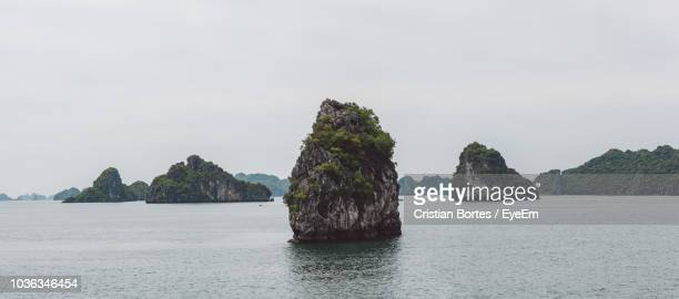 scenic view of rocks in sea against sky - bortes stock photos and pictures