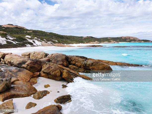scenic view of rocks in sea against sky - western australia stock pictures, royalty-free photos & images