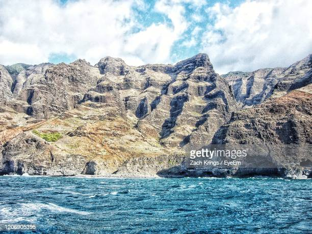 scenic view of rocks in sea against sky - krings stock pictures, royalty-free photos & images