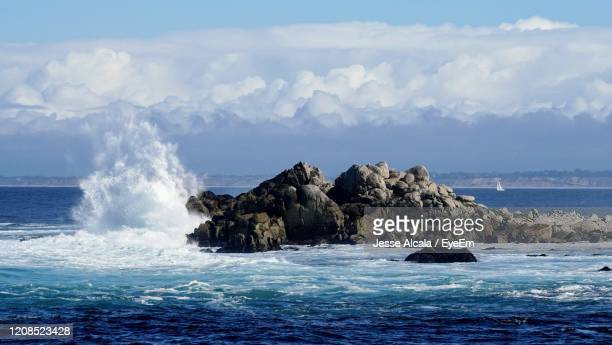 scenic view of rocks in sea against sky - jesse stock pictures, royalty-free photos & images
