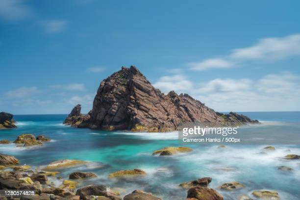 scenic view of rocks in sea against sky,naturaliste,western australia,australia - images stock pictures, royalty-free photos & images