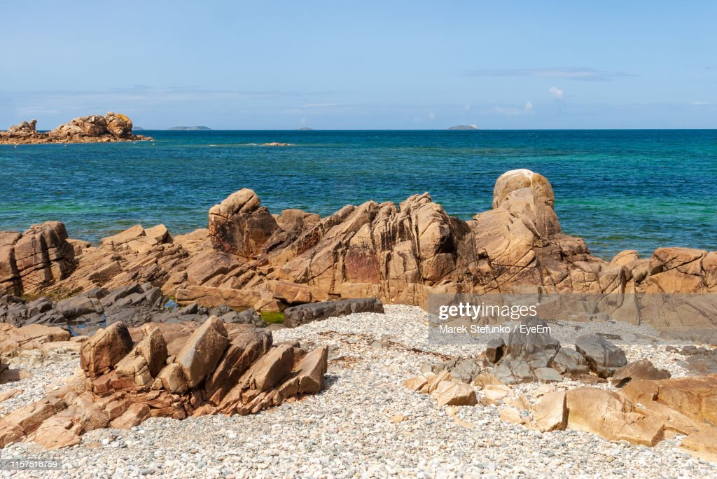 Scenic View Of Rocks On Beach Against Sky : Stock Photo