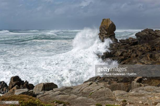 scenic view of rocks on shore against sky - france strike stock pictures, royalty-free photos & images