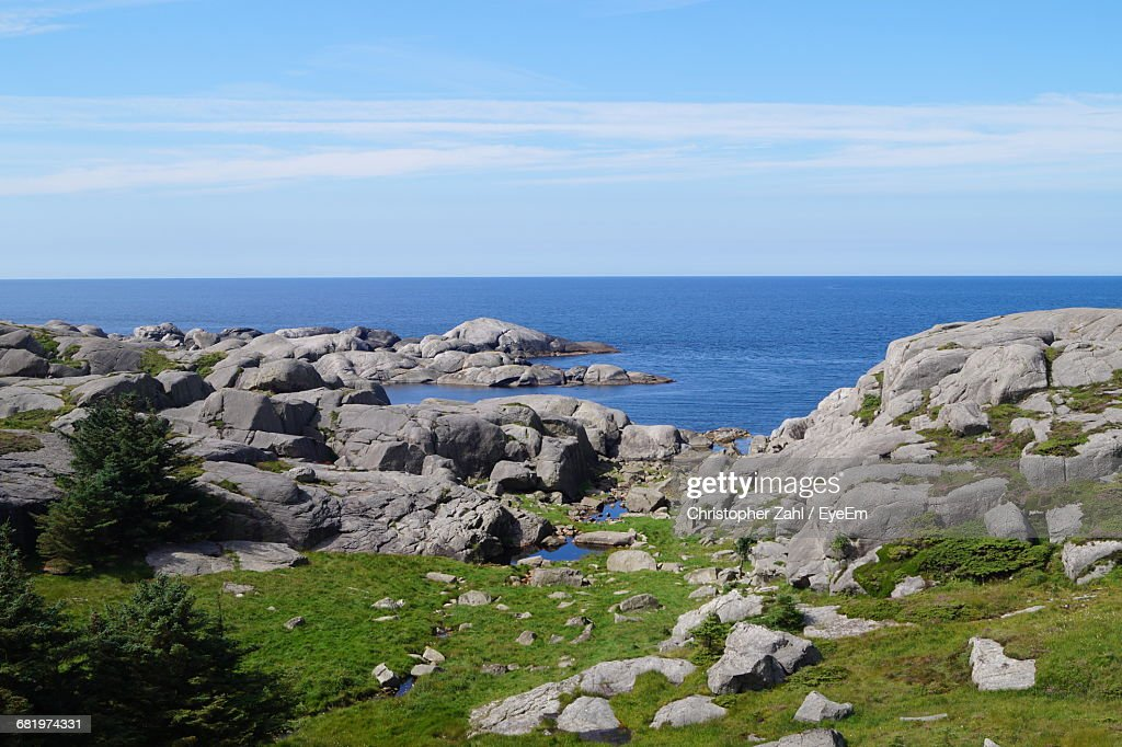 Scenic View Of Rocky Beach Against Sky : Stock Photo