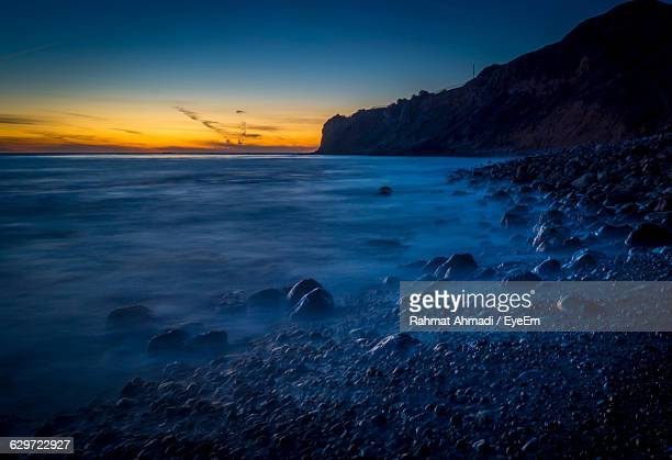 scenic view of rocky coastline against sky during sunset - rancho palos verdes stock pictures, royalty-free photos & images