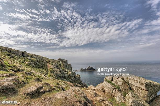 Scenic View Of Rocky Mountain By Sea Against Sky