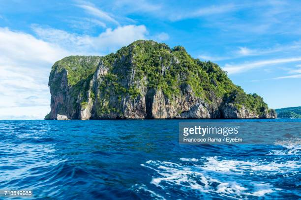 Scenic View Of Rocky Mountain In Sea Against Blue Sky At Ko Phi Phi Le