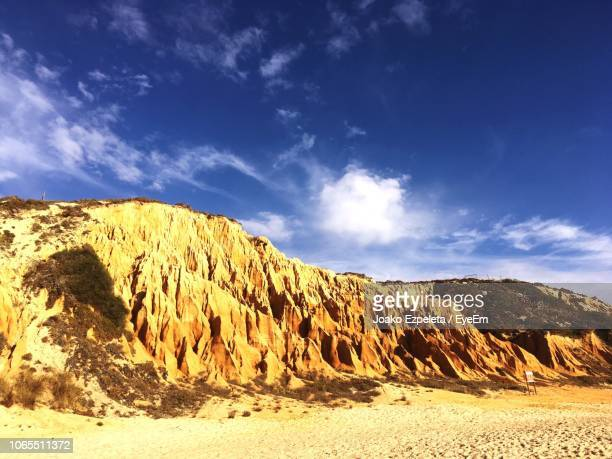 scenic view of rocky mountains against blue sky - comporta portugal stock photos and pictures