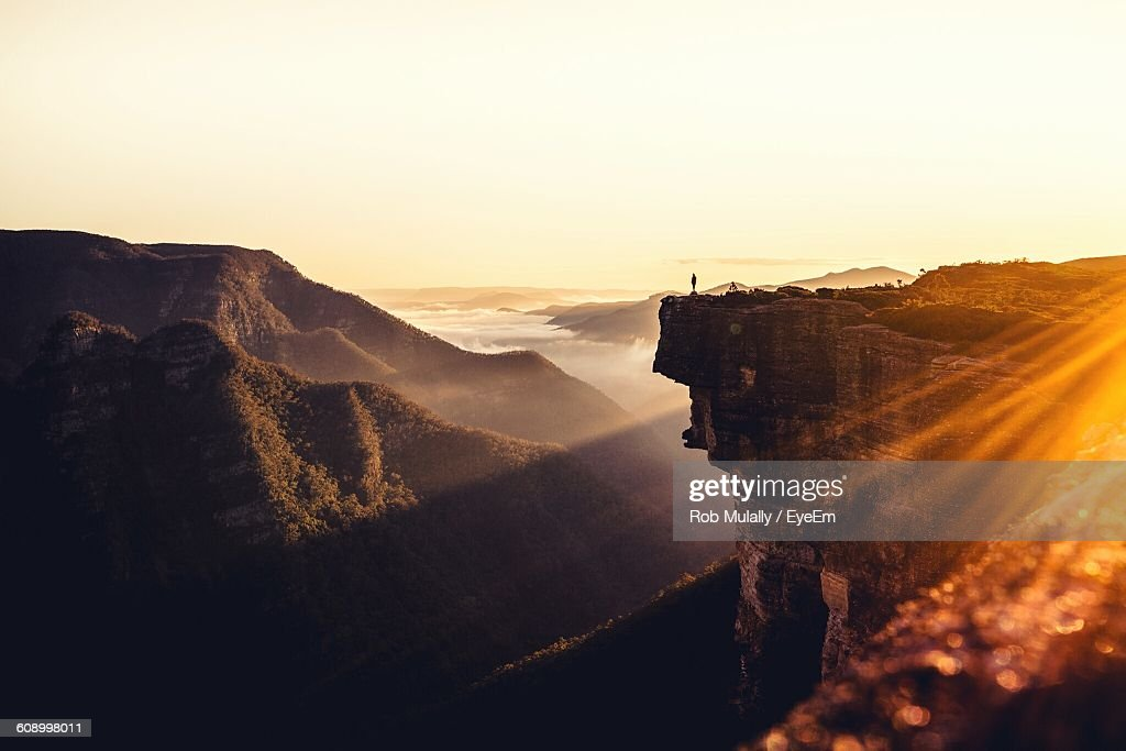 Scenic View Of Rocky Mountains Against Clear Sky On Sunny Day : Stock Photo