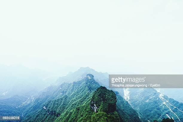 scenic view of rocky mountains against clear sky - tianmen stock pictures, royalty-free photos & images