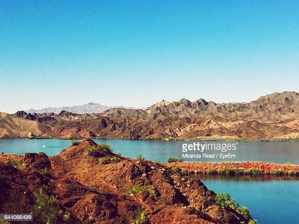 scenic view of rocky mountains against clear sky - lake havasu stock photos and pictures
