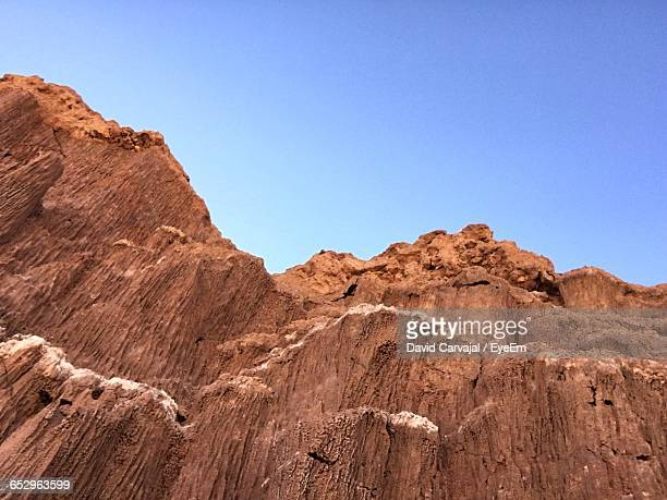 scenic view of rocky mountains against clear sky - carvajal stock photos and pictures