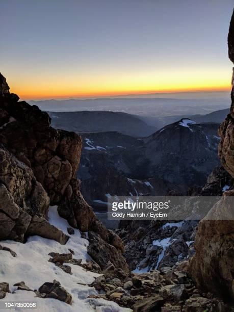 scenic view of rocky mountains against sky during sunset - beaver creek colorado stock pictures, royalty-free photos & images