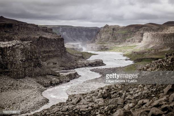 scenic view of rocky mountains against sky - selfoss stock photos and pictures
