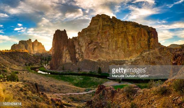scenic view of rocky mountains against sky - smith rock state park stock pictures, royalty-free photos & images