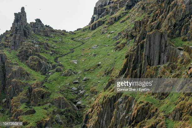 scenic view of rocky mountains against sky - skellig michael ストックフォトと画像