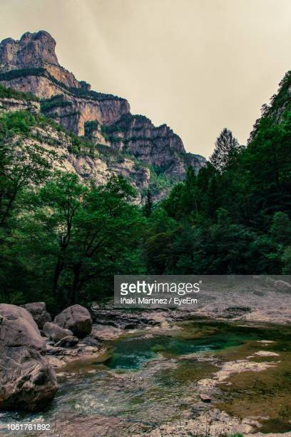 scenic view of rocky mountains against sky - iñaki mt stock photos and pictures