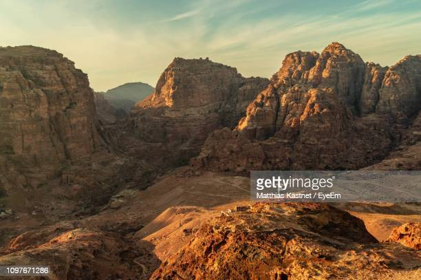 scenic view of rocky mountains against sky - jordan middle east stock pictures, royalty-free photos & images