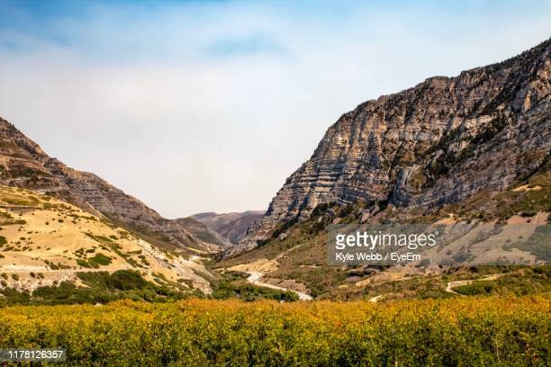 scenic view of rocky mountains against sky - provo stock pictures, royalty-free photos & images