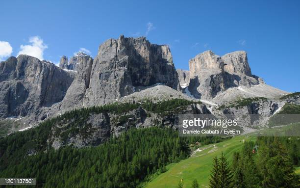 scenic view of rocky mountains against sky - alta badia stock pictures, royalty-free photos & images