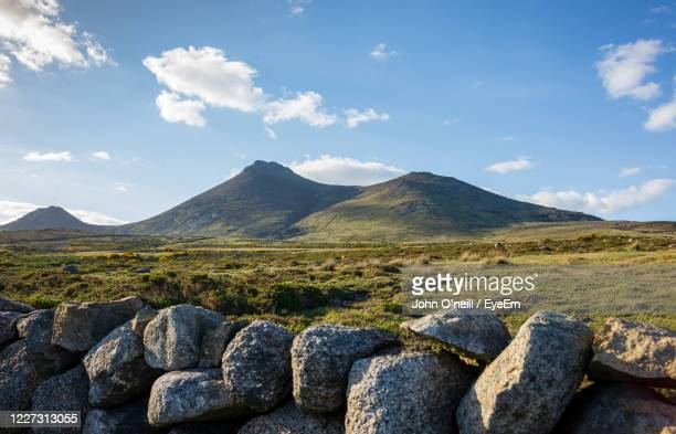 scenic view of rocky mountains against sky - northern ireland stock pictures, royalty-free photos & images
