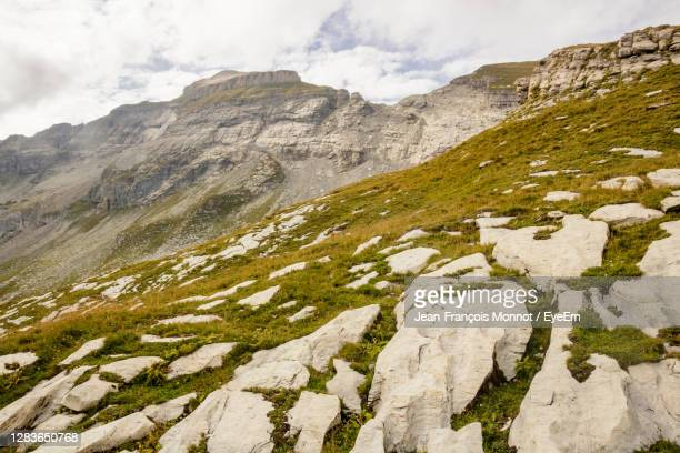 scenic view of rocky mountains against sky - sallanches stock pictures, royalty-free photos & images