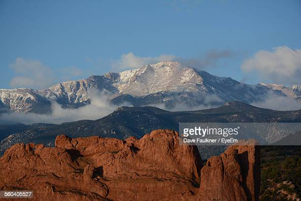 scenic view of rocky mountains against sky - dave faulkner eye em stock pictures, royalty-free photos & images