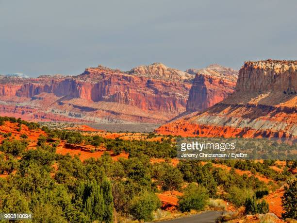 scenic view of rocky mountains against sky - capitol reef national park stock pictures, royalty-free photos & images