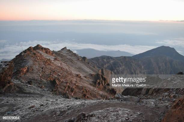 scenic view of rocky mountains against sky - arusha national park stock photos and pictures